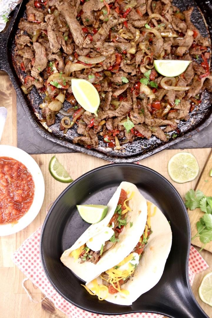 Platter with steak fajitas, bowl with 2 steak fajitas in tortillas