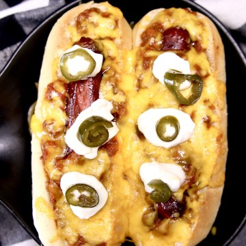 Best Chili Dogs topped with sour cream and candied jalapenos
