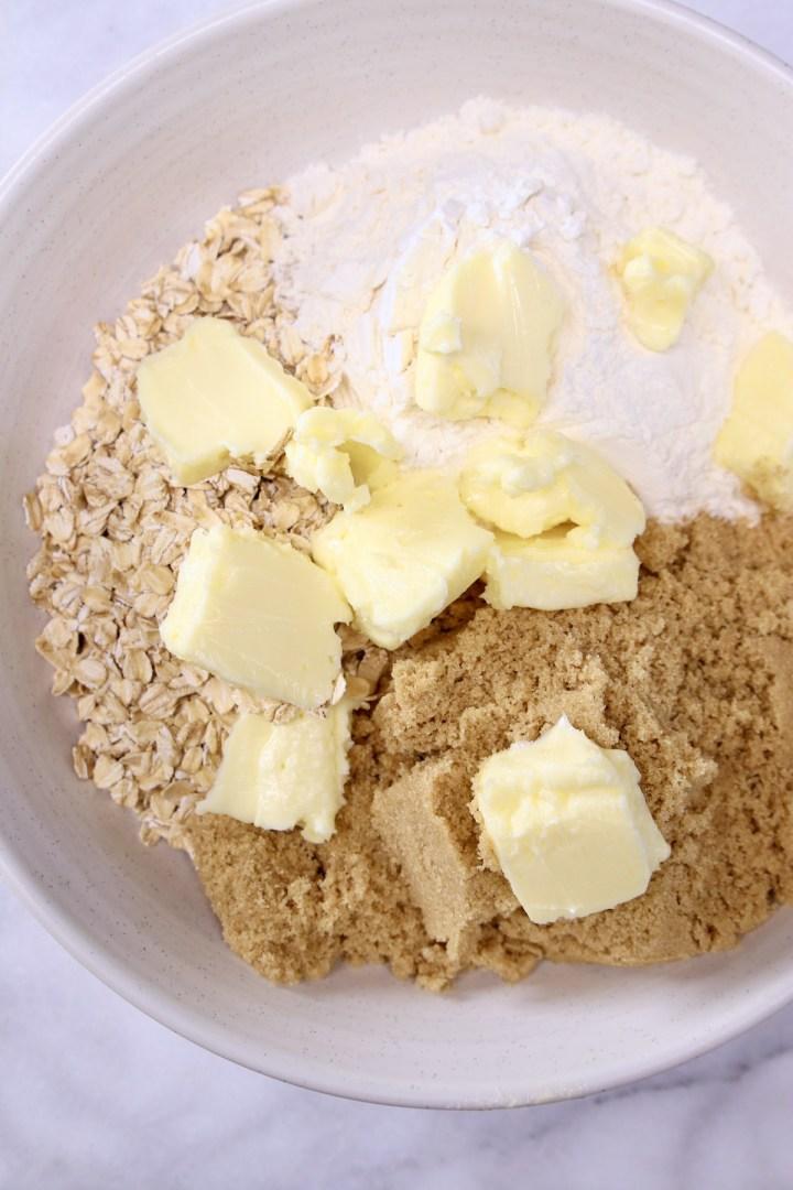 bowl with brown sugar, flour, oats, butter cut up