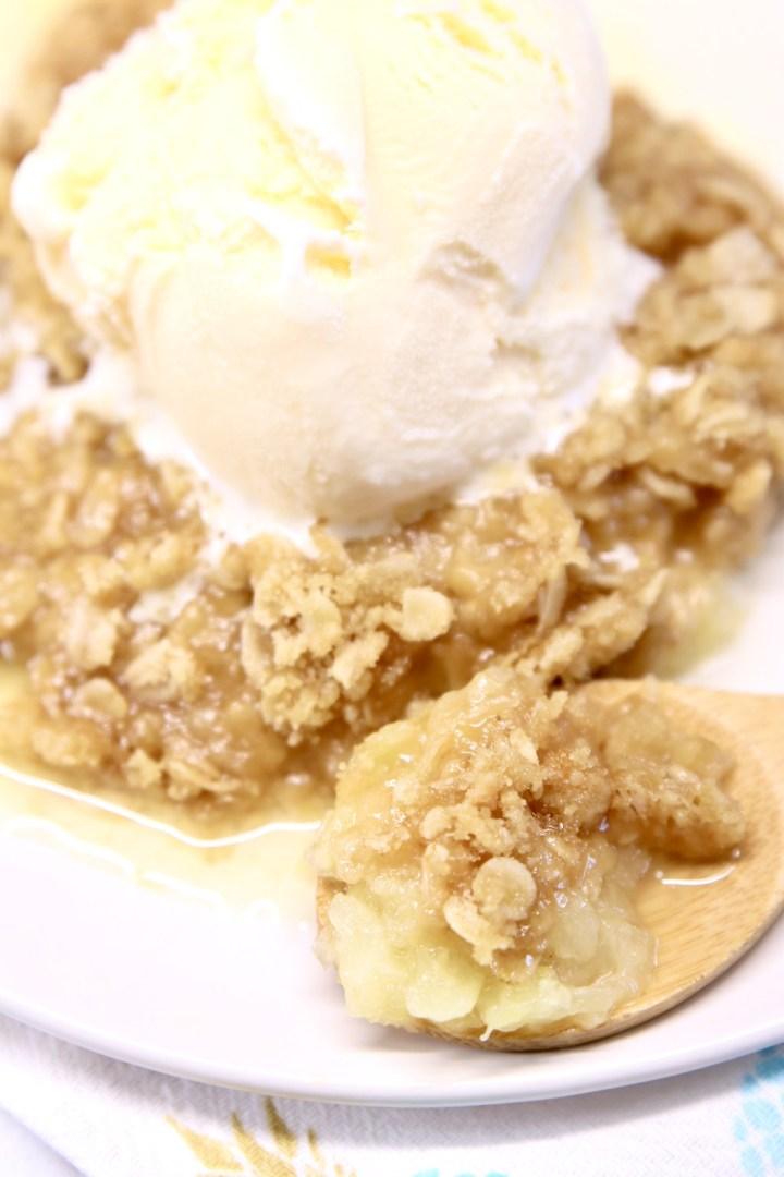 Vanilla ice cream served over pineapple crisp