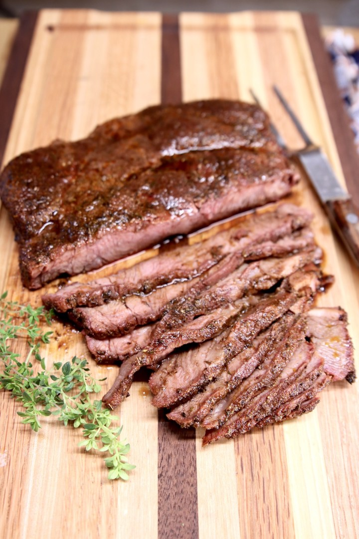 Chuck roast on cutting board, sliced
