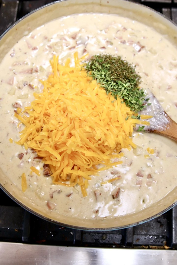 creamy ham soup - adding cheese and herbs