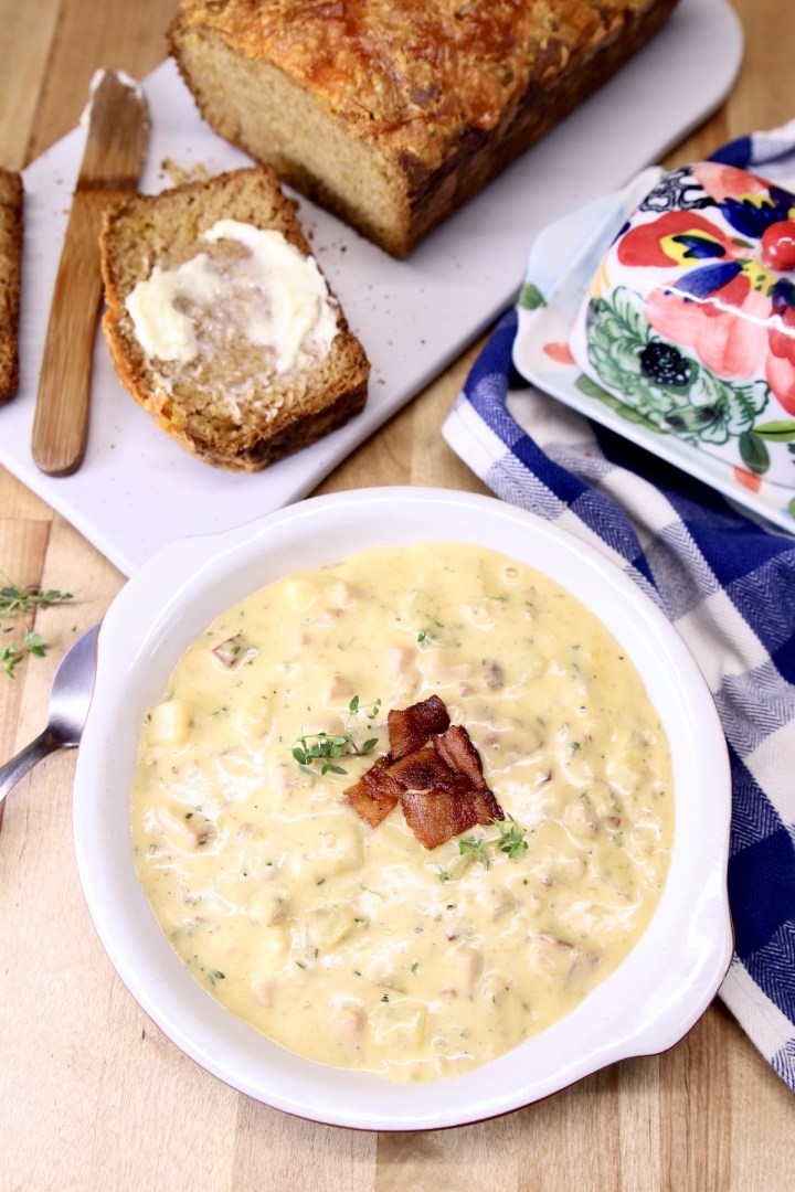 ham and cheese soup with loaf of bread