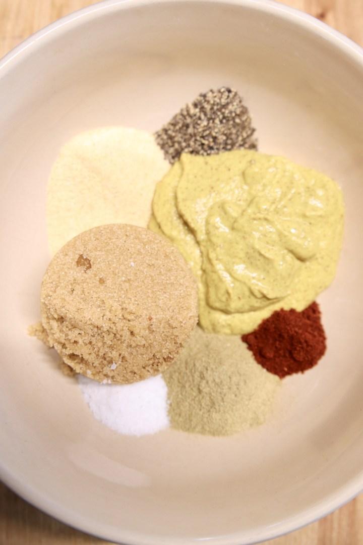 mustard brown sugar ham glaze with spices in a bowl