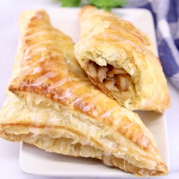 apple turnovers on a plate - one with filling showing