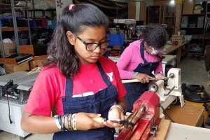 Woodworking classes for girls in an orphanage
