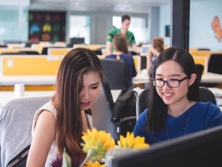 Two women in conversation | impact-based loan