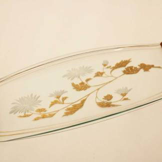 Sandwich plate.  Clear with gold and white flower motif. Teak handles each end.