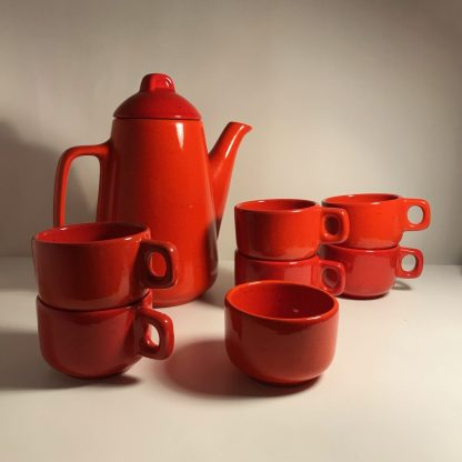 orange coffee pot with cups and sugar bowl label main