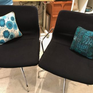 pair black wool and chrome swivel chairs