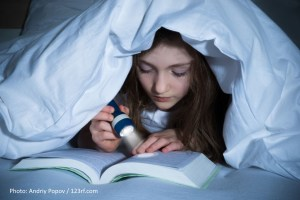 Reading in Bed with Flashlight