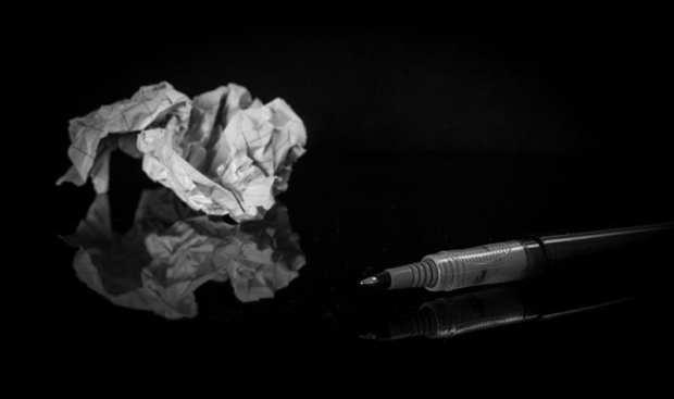 wad of trash next to pen representing lenten resolution