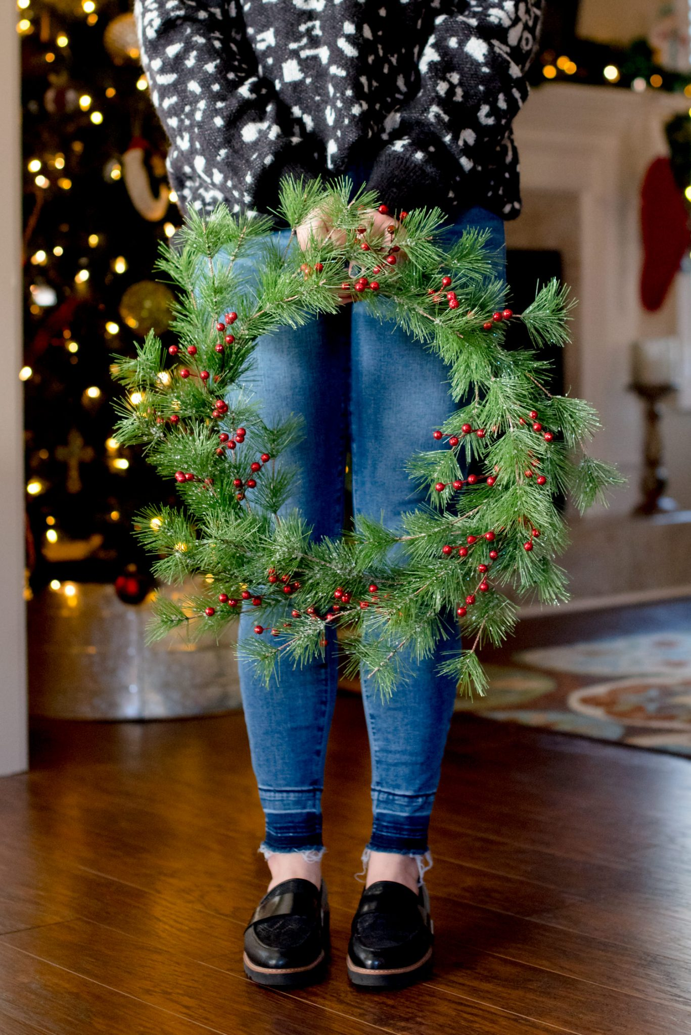 Make Your Own DIY Christmas Wreath // Miss Molly Moon, featured by top Atlanta life and style blog, Miss Molly Moon: picture of a woman holding a DIY Christmas Wreath