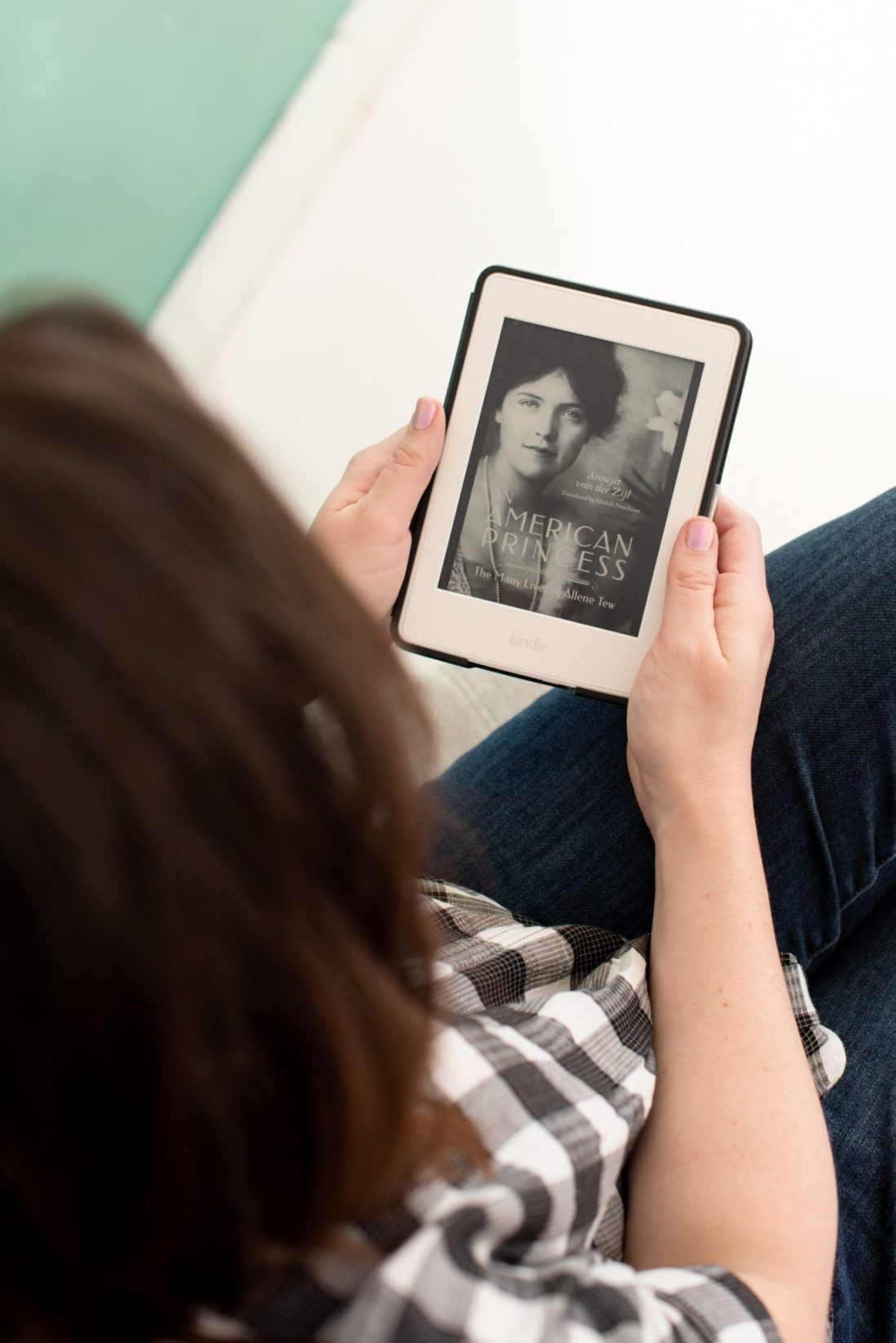 Celebrate World Book Day with Amazon Crossing featured by top US lifestyle blogger, Miss Molly Moon: image of a woman holding a reader with American Princess cover