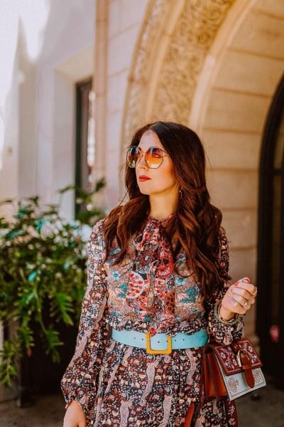Girl wearing paisley dress and sunglasses