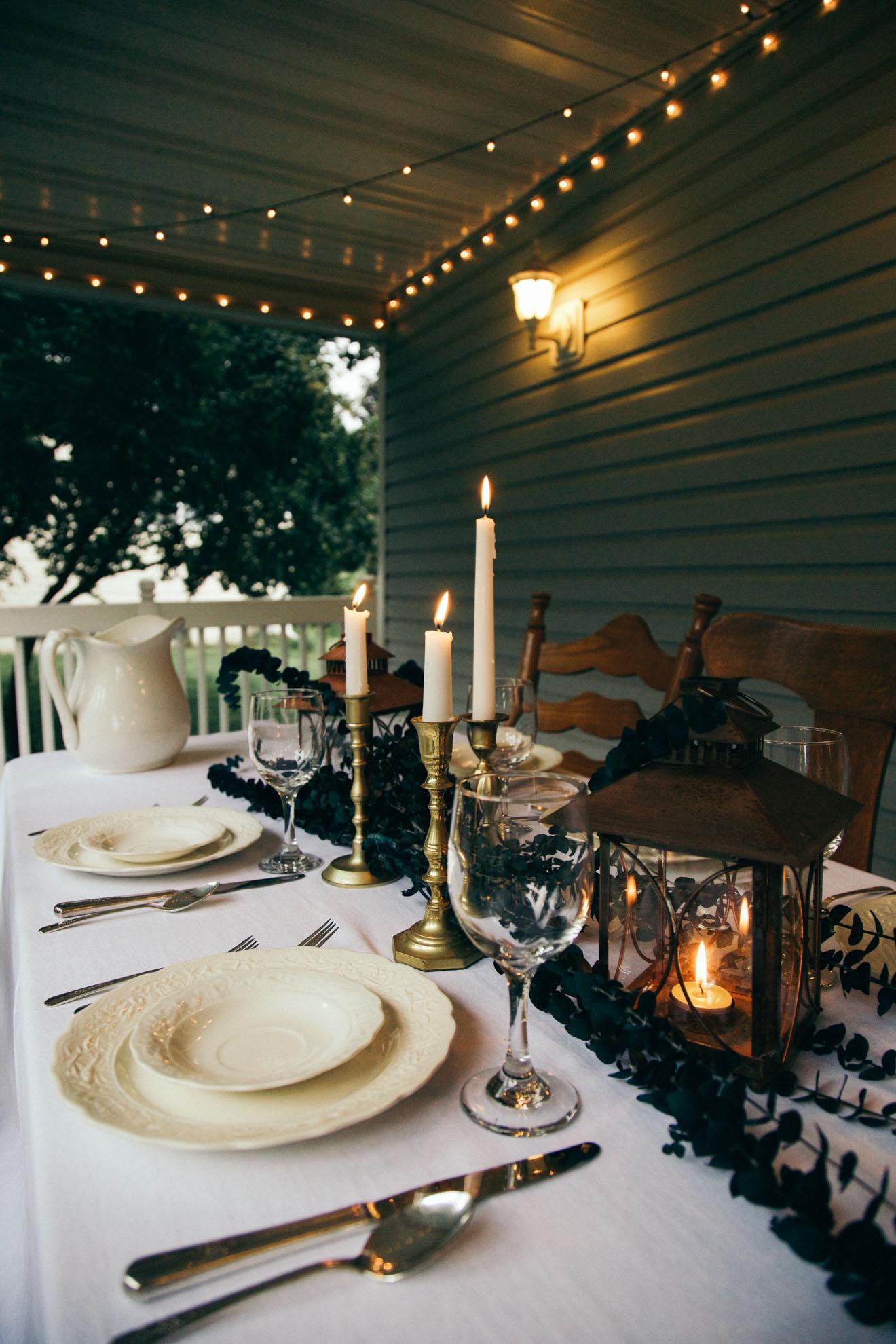 back porch dinner table white lights