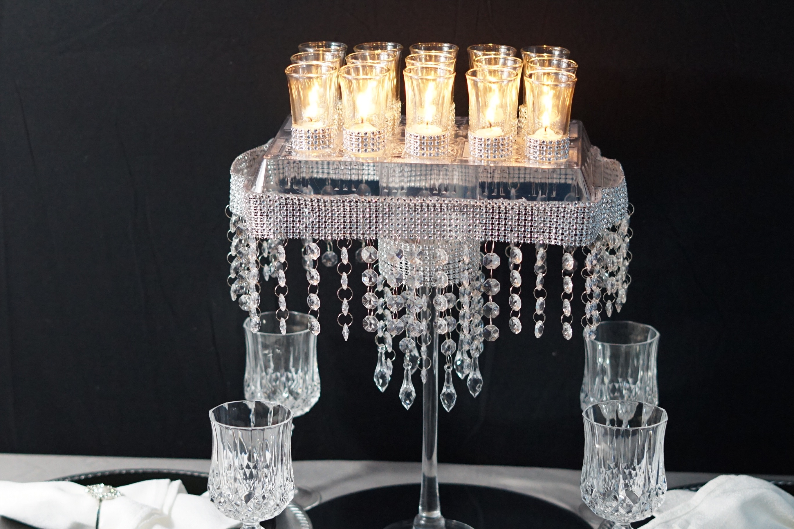 Diy candle glam wedding centerpiece lets glam it up this week with our diy candle glam wedding centerpiece adorned with gems rhinestone trim and candles this blinged out table decor is junglespirit Image collections
