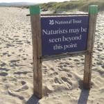 Studland beach naturist warning sign