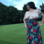 Lady flashing her breasts at the first hole of a golf course