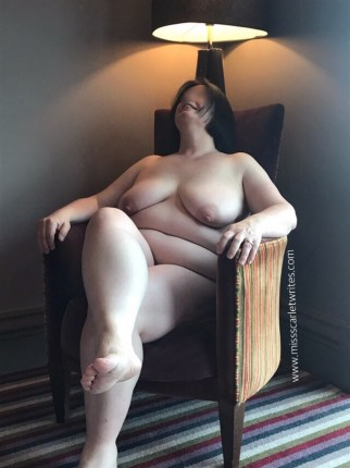 Nude woman in a chair