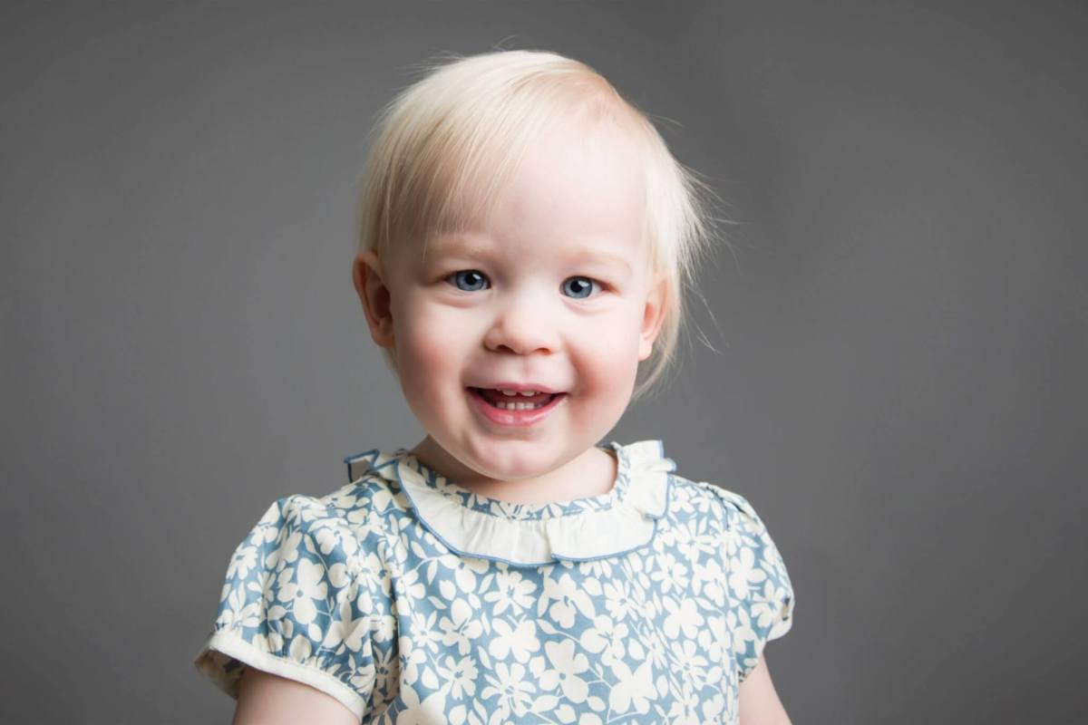 two year old toddler girl studio portrait session grey backdrop, simple, clean, timeless