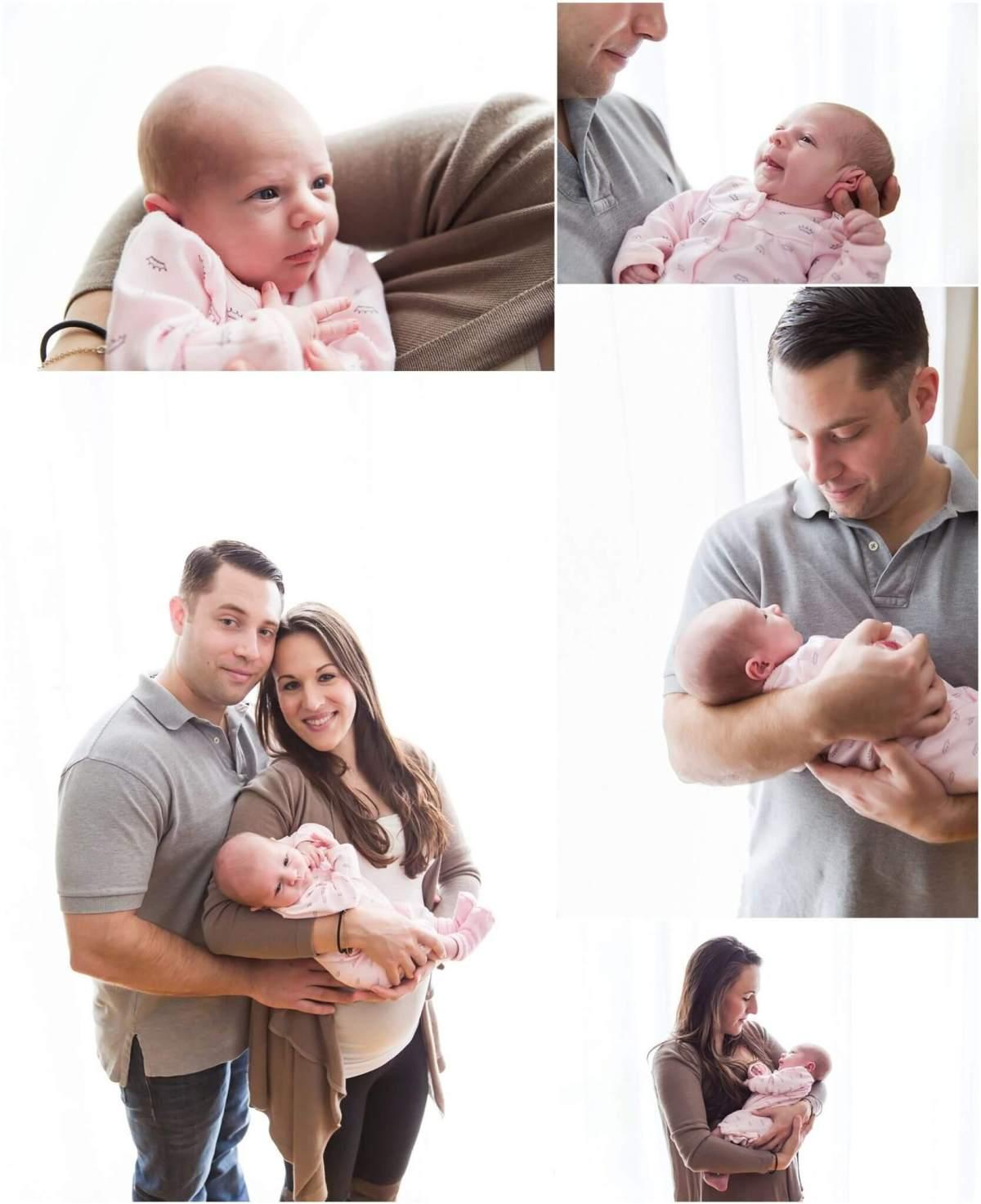 lifestyle newborn session. family holding newborn baby girl using large window as softbox backlighting them.