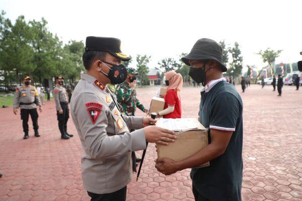 PPKM Darurat, Poldasu Beri Bantuan 5.000 Paket Bansos Pada Warga