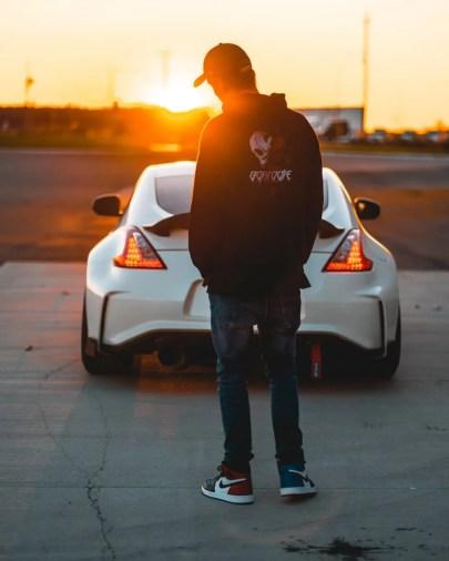 car sharing- boy looking at white car