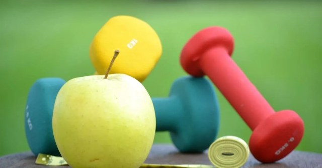 healthy lifestyle- fruits and dumbells