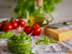 green pesto sauce in a glass conatiner