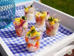 ceviche in shot glasses served on a white tray