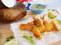cassava chips on a board with lime wedges