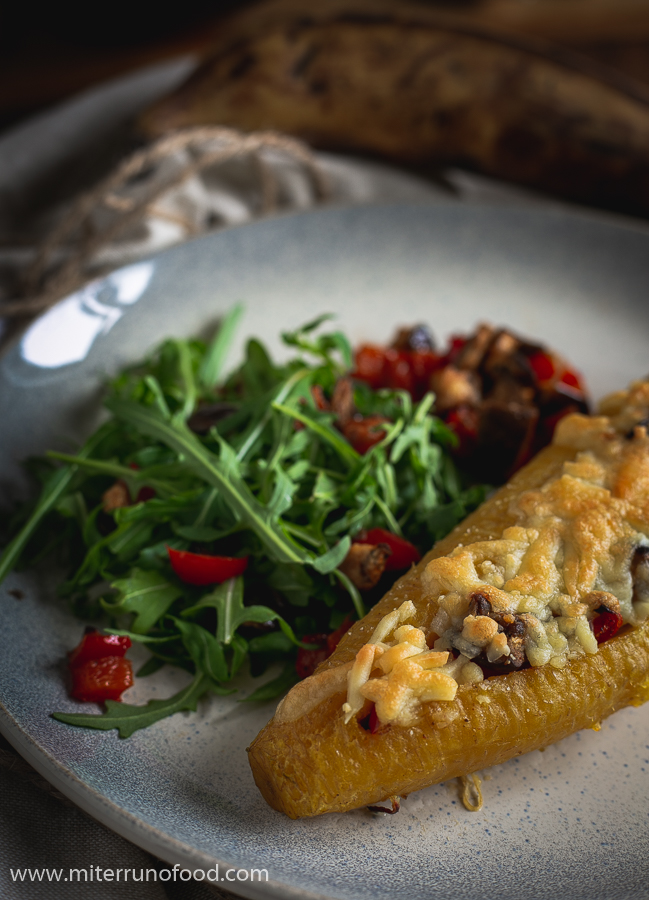 plantain baked on a plate with salad