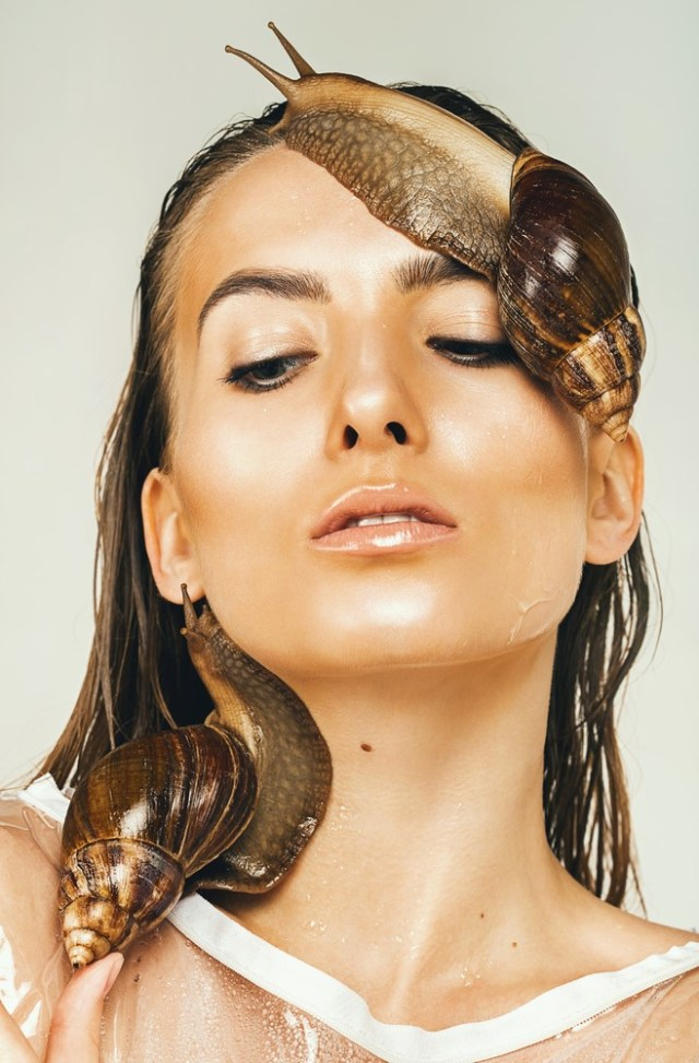Snails on woman's face