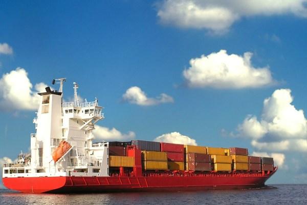 Handelsabkommen Schiff Container Foto