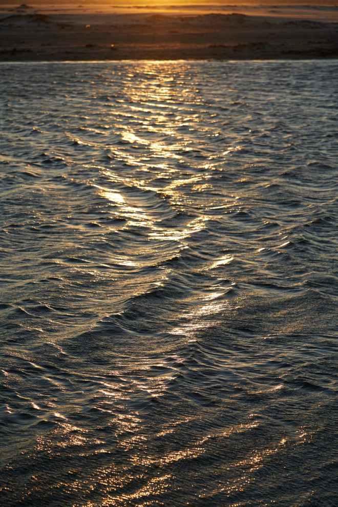 rippling sea water at sundown