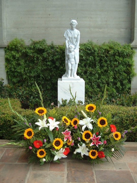 A Scene Michael Would Love - HIs Flowers next to a Mother and Child statue near the Terrace
