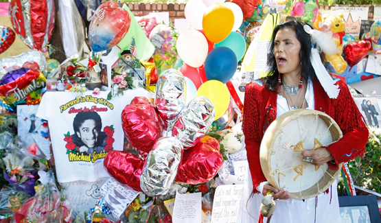 Joanelle Romero with drum, balloons, and MJ T-Shirt