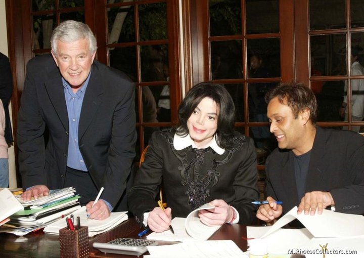 Michael, and Ragu Patel singing 'Neverland Entertainment' deal