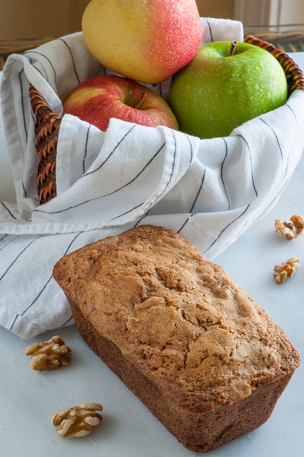 Apple walnut cake with rum butter sauce. This is a moist cake recipe that's filled with apples and walnuts and is topped with a swoon-worthy rum butter sauce. | mjbakesalot.com