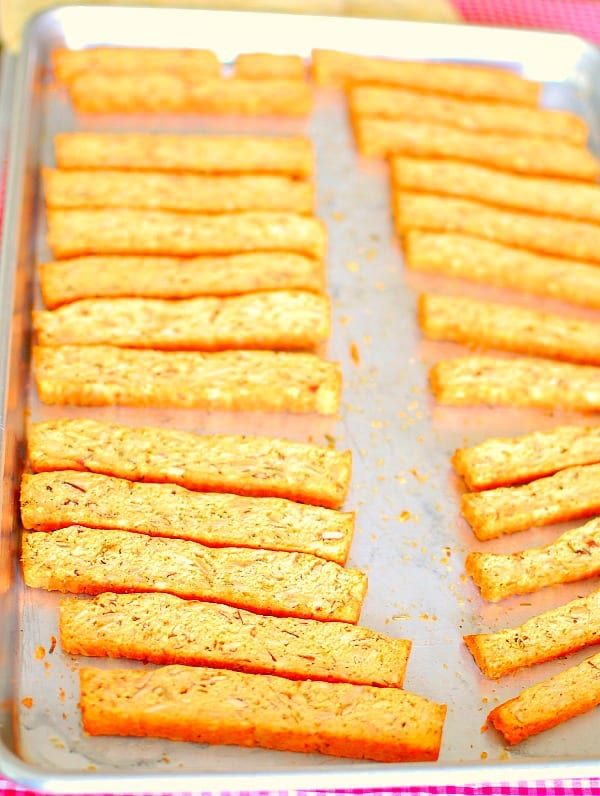 Savory biscotti with parmesan and rosemary is a recipe that will make a great addition to your appetizer repertoire. They're delicious with cheese, dips or spreads, and wine or cocktails. | mjbakesalot.com