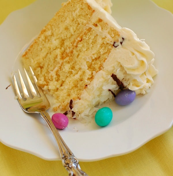This easy recipe for Sensational Coconut Layer Cake with Coconut Cream Cheese Frosting has golden layers of moist butter cake alternating with everyone's favorite frosting. Make it for Easter, for spring, for a birthday, for your book club! | mjbakesalot.com