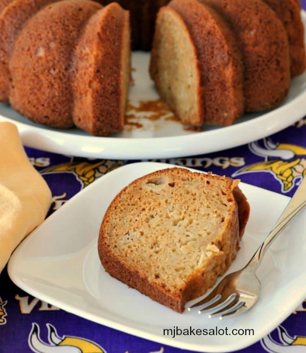 A slice of honey apple Bundt cake without any topping. | mjbakesalot.com