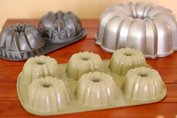 Three different cake pans that benefit from proper Bundt pan prep; Bundt Duet pan, Original 12-cup pan, and Bundtlette pan. | mjbakesalot.com