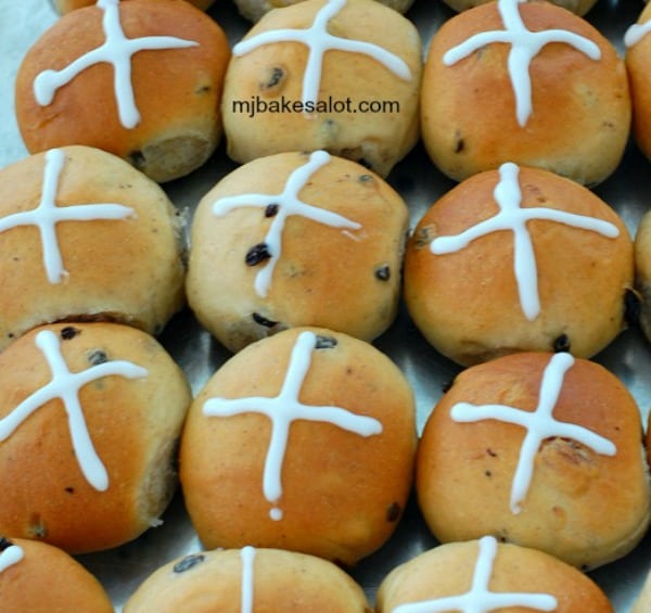 Hot cross buns are baked and decorated and ready to be enjoyed.   mjbakesalot.com