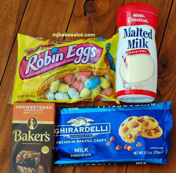 """Chocolate malt cake with vanilla malt frosting gets it's great flavor from malted milk powder, milk chocolate chips, and unsweetened baking chocolate, while malted milk """"robin eggs"""" decorate the top. 