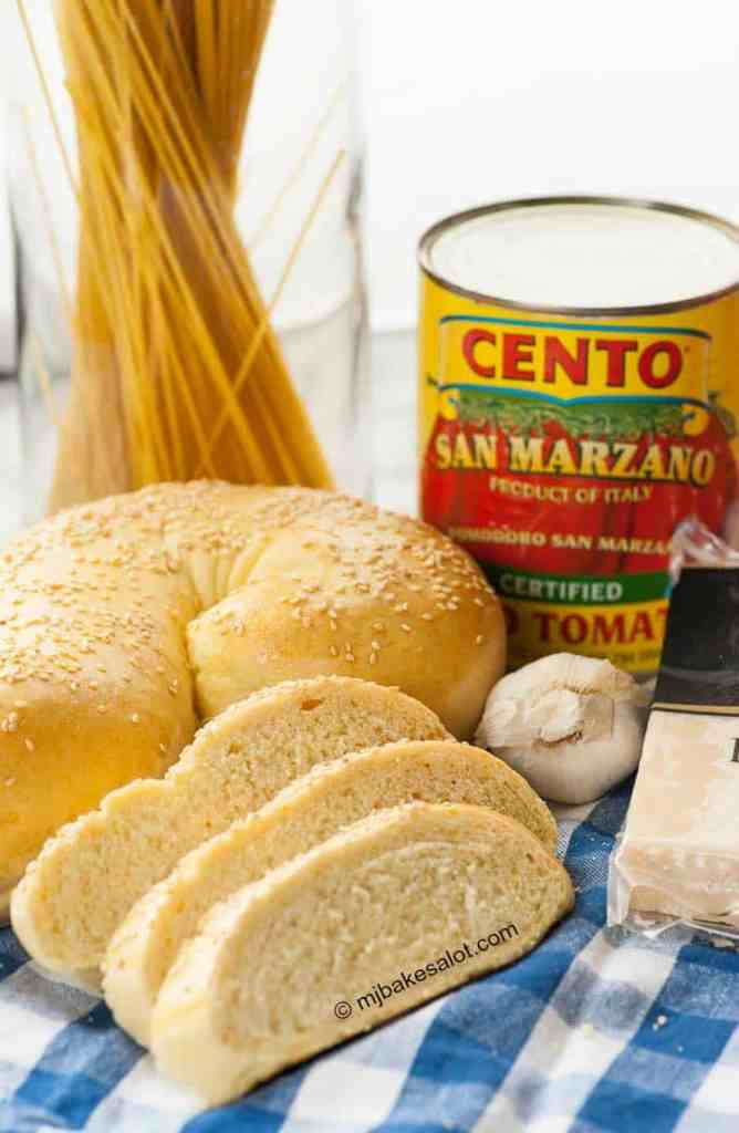 This easy but impressive golden Italian semolina bread is molto delizioso with any Italian meal or for sandwiches. The semolina flour that gives it such a beautiful color also makes the bread tender, light, and flavorful while the sesame seeds add flavor and a pleasing crunch. | mjbakesalot.com