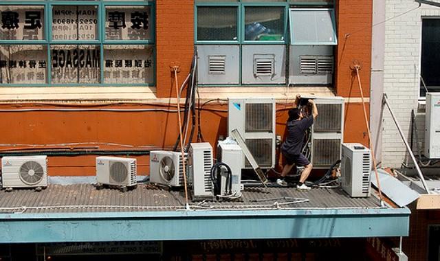 A man installing the HVAC