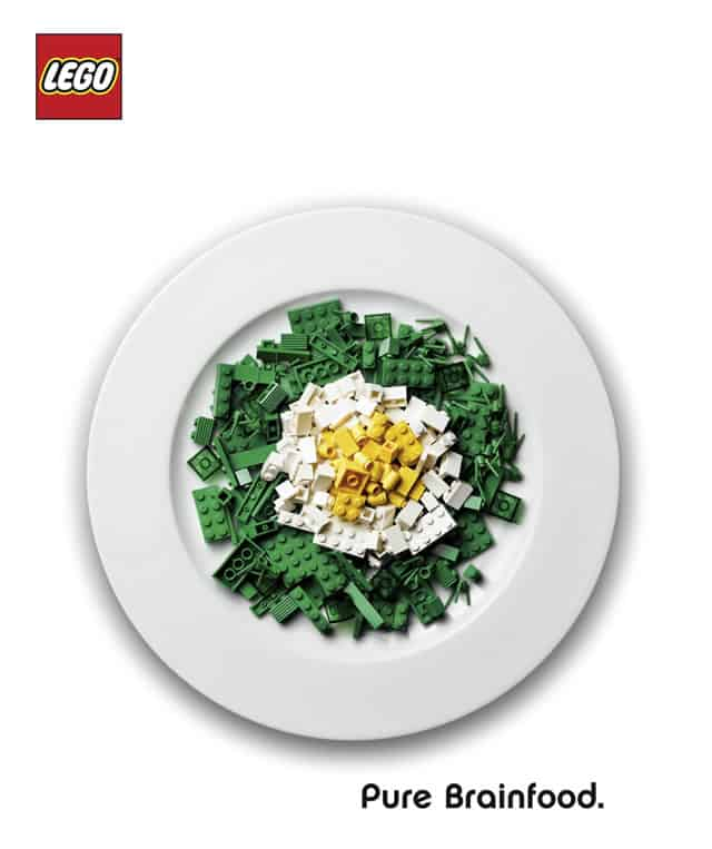 """Targeted marketing ad aimed at parents. It's an image of a plate of LEGOs that look like a salad and labeled, """"Brainfood."""""""