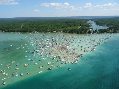 Fourth of July 2020 on Torch Lake  Several people at massive Torch Lake July 4 party have tested positive for coronavirus – MLive.com VIBSCYTMTBGWVHIGXMCTAYRJJM